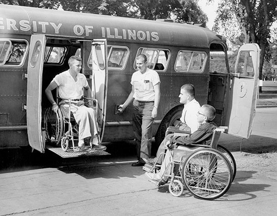 student using wheelchair lift to exit a bus, 1955